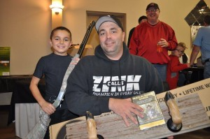 Silent Auction Bonus Winner, Dustin Thoms, Lincoln, NE - deer foot gun rack + CVA muzzleloader.