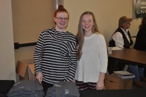 Emma (daughter of volunteer, Jon Slaga) & Abby (daughter of volunteer Jeremy Schaaf) helping out at the t-shirt table