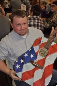 Andrew Cockerill, winner of the autographed Ted Nugent guitar to benefit the Ted Nugent Kamp for Kids in Omaha.